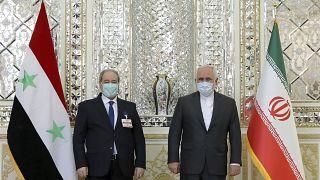 وزير الخارجية محمد جواد ظريف ونظيره السوري فيصل مقداد