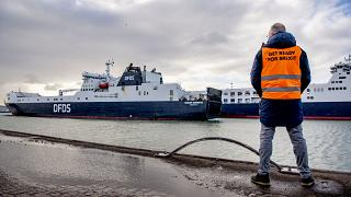 A man stand at the DFDS buffer zone before a press conference, as part of the Get Ready For Brexit campaign, at the DFDS ferry terminal at Rotterdam port, December 1, 2020.