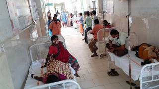 Patients and their bystanders are seen at the district government hospital in Eluru