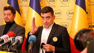 George Simion, right, and Claudiu Tarziu, the leaders of the Alliance for the Unification of Romanians (AUR)