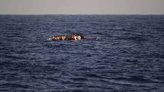 Migrants on a wooden boat in the Mediterranean