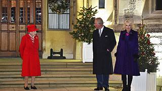 Queen Elizabeth II stood outside Windsor Castle with Prince Charles and Camilla.