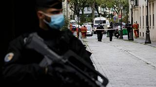 A French gendarme guards a street after a knife attack near the former offices of satirical newspaper Charlie Hebdo, Friday Sept. 25, 2020 in Paris.