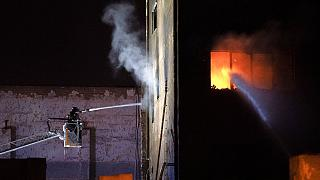 Twenty teams of fire fighters tackle a blaze at a warehouse in Catalonia.