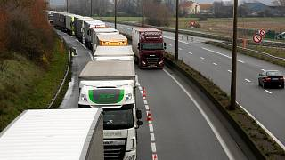 Lorries queue along the A16 motorway to board ferries to reach England, near Calais, northern France, Wednesday, Dec. 9 2020.