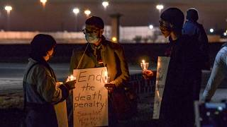 A protest against the execution of Brandon Bernard across Prairieton Road from the Federal Death Chamber in Terre Haute, Ind., on Thursday evening, Dec. 10, 2020.