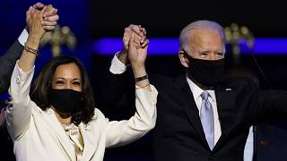 Vice President-elect Kamala Harris holds hands with President-elect Joe Biden and her husband Doug Emhoff as they celebrate Saturday, Nov. 7, 2020, in Wilmington, Delaware.