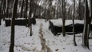 Improvised tents at a makeshift camp in a forest outside Velika Kladusa, Bosnia and Herzegovina.
