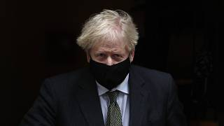 Prime Minister Boris Johnson leaves 10 Downing Street to attend the weekly Prime Ministers' Questions session in parliament in London, Wednesday, Dec. 9, 2020.