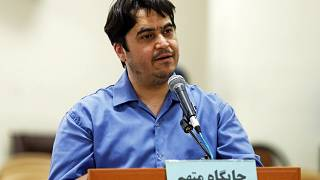 In this June 2, 2020 photo, journalist Ruhollah Zam speaks during his trial at the Revolutionary Court, in Tehran, Iran.