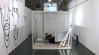 "Artist Gaetan Marron in his cube for his project ""Non essential"""