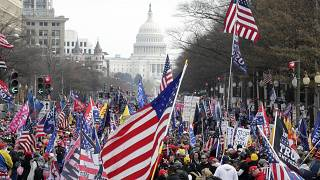 With the U.S. Capitol building in the background, supporters of President Donald Trump stand Pennsylvania Avenue during a rally at Freedom Plaza, Saturday, Dec. 12, 2020.