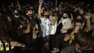 Volunteers dance during a concert in Barcelona, Spain, Saturday, Dec. 12, 2020.
