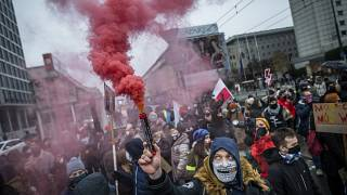 Protesters take part in demonstration of Women's Right movement to mark the anniversary of the introduction of martial law in communist Poland.