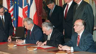 Serbian president Slobodan Milosevic, Bosnian President Alija Izetbegovic (C) & Croatian President Franjo Tudjman sign the Dayton peace deal on 14 December 1995 in Paris