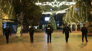 Police officers walking while patrolling empty boulevard