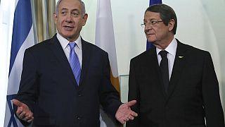 Cyprus' president Nikos Anastasiades, left, talks with Israeli Prime Minister Benjamin Netanyahu