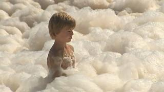 Australia's Gold Coast beaches swamped by foam caused by rough seas