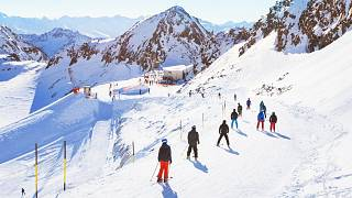 Skiers on a slope in the Alps.