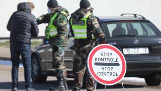 Lithuanian police check a driver at Kalvarija-Budzisko border crossing with Poland on March 15, 2020, before frontiers were closed during the first coronavirus wave.
