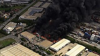 Huge plumes of smoke from a recycling plant billowed across the city