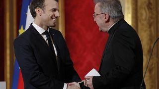 FILE: In this Jan.4, 2018 file photo, French President Emmanuel Macron greets Apostolic Nuncio to France Luigi Ventura during his New Year address to diplomats.