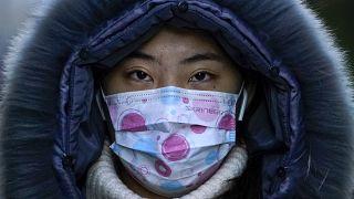 امرأة صينية في شوارع العاصمة بكين