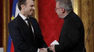 Former Vatican ambassador in France Mgr Luigi Ventura with French President Emmanuel Macron