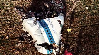 In this Dec. 22, 1988, file photo police and investigators look at what remains of the nose of Pan Am 103 in a field in Lockerbie, Scotland.