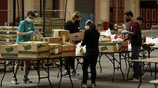 Volunteers check the quality of donated food to be put in packs delivered to residents who need it in the Haringey Council area, London, April 2020.