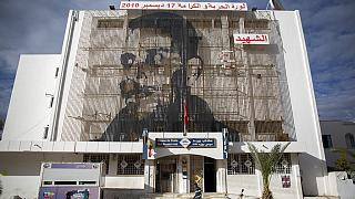 Mohammed Bouazizi is depicted on the facade of post office in Sidi Bouzid, Tunisia, on Friday Dec.11, 2020.