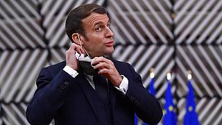 French President Emmanuel Macron reacts as he meets Portuguese Prime Minister Antonio Costa, Wednesday, Dec. 16, 2020 in Paris.