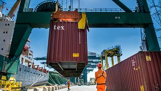 Containers being offloaded at the Port of Antwerp, Belgium.