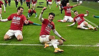 Szoboszlai és csapattársai a magyar válogatott kijutását ünneplik a 2021-es Európa-bajnokságra az Izland elleni pótselejtező után.