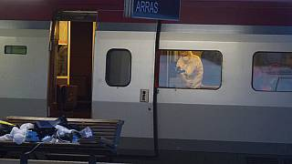 A police officer videos the crime scene inside a Thalys train at Arras train station, after a gunman opened fire with an automatic weapon