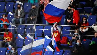 Russian spectators support their team during the Channel One Cup ice hockey match between Sweden and Russia in Moscow, Russia, Thursday, Dec. 17, 2020.