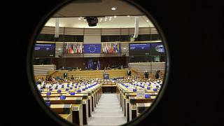 A general view through the door of the hemicycle at a plenary session of the European Parliament