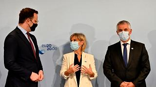 Slovenia's Tomaz Gantar, right, before a joint video conference with EU health ministers in Berlin, Germany, Thursday, July 16, 2020.