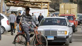 March 16, 2013 file photo, an Egyptian bread vendor rides his bicycle in downtown Cairo, Egypt