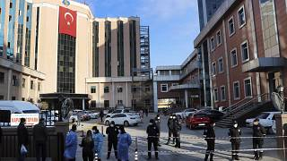 Police and medics gather outside the privately-run Sanko University Hospital in Gaziantep, southeastern Turkey, Saturday, Dec. 19, 2020