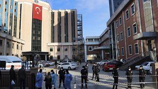 Police and medics gather outside the privately-run Sanko University Hospital in Gaziantep, southeastern Turkey, Saturday, Dec. 19, 2020