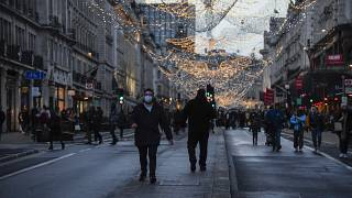 A man wears a face mask while he walks in Regent Street, ahead of the new Tier-4 restriction measures.