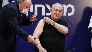 Israeli Prime Minister Minister Benjamin Netanyahu receives a coronavirus vaccine at Sheba Medical Center in Ramat Gan, Israel on Saturday, Dec. 19, 2020