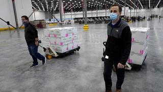Boxes containing the Moderna COVID-19 vaccine are moved to the loading dock for shipping at the McKesson distribution center in Olive Branch, Miss., Sunday, Dec. 20, 2020
