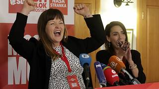 Irma Baralija greets supporters in her headquarters after local election in Mostar, Bosnia, Sunday, Dec. 20, 2020.