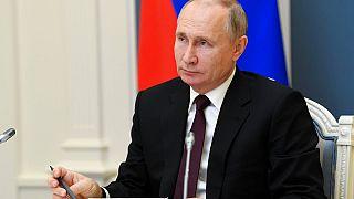 Russian President Vladimir Putin attends a meeting to mark a memorandum of cooperation on the fight against the coronavirus