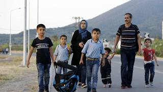 A Syrian family head to Mytilene to be counted by Greek authorities
