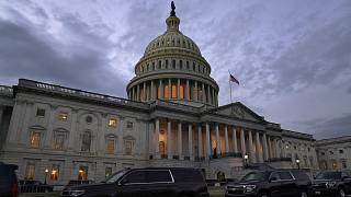 Dusk falls over the Capitol, Monday, Dec. 21, 2020, in Washington. Congressional leaders have hashed out a massive, year-end catchall bill on Monday, Dec. 22, 2020.