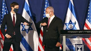 White House senior adviser Jared Kushner, left, elbow bumps Israeli Prime Minister Benjamin Netanyahu