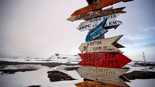 n this Jan. 20, 2015, file photo, wooden arrows show the distances to various cities on King George Island, Antarctica.